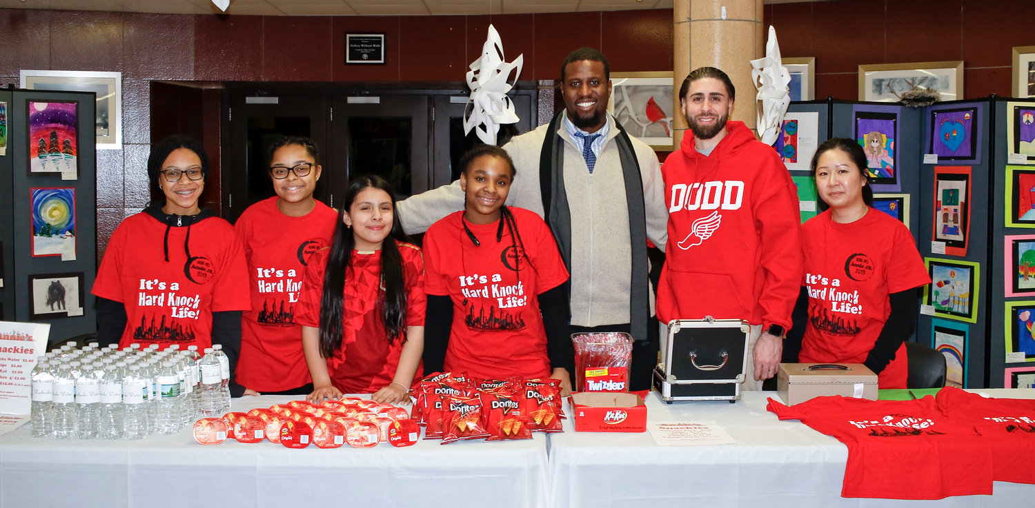 "Teachers and the Ladies of Dodd, from left, Linsey Matthews-Correia, Ana James, Valeria Pizarro, Zuri Eccleston, Marques McFarlin, Anthony Dalli and Dawney Pang sold snacks and ""Warbucks Water"" during the intermission."