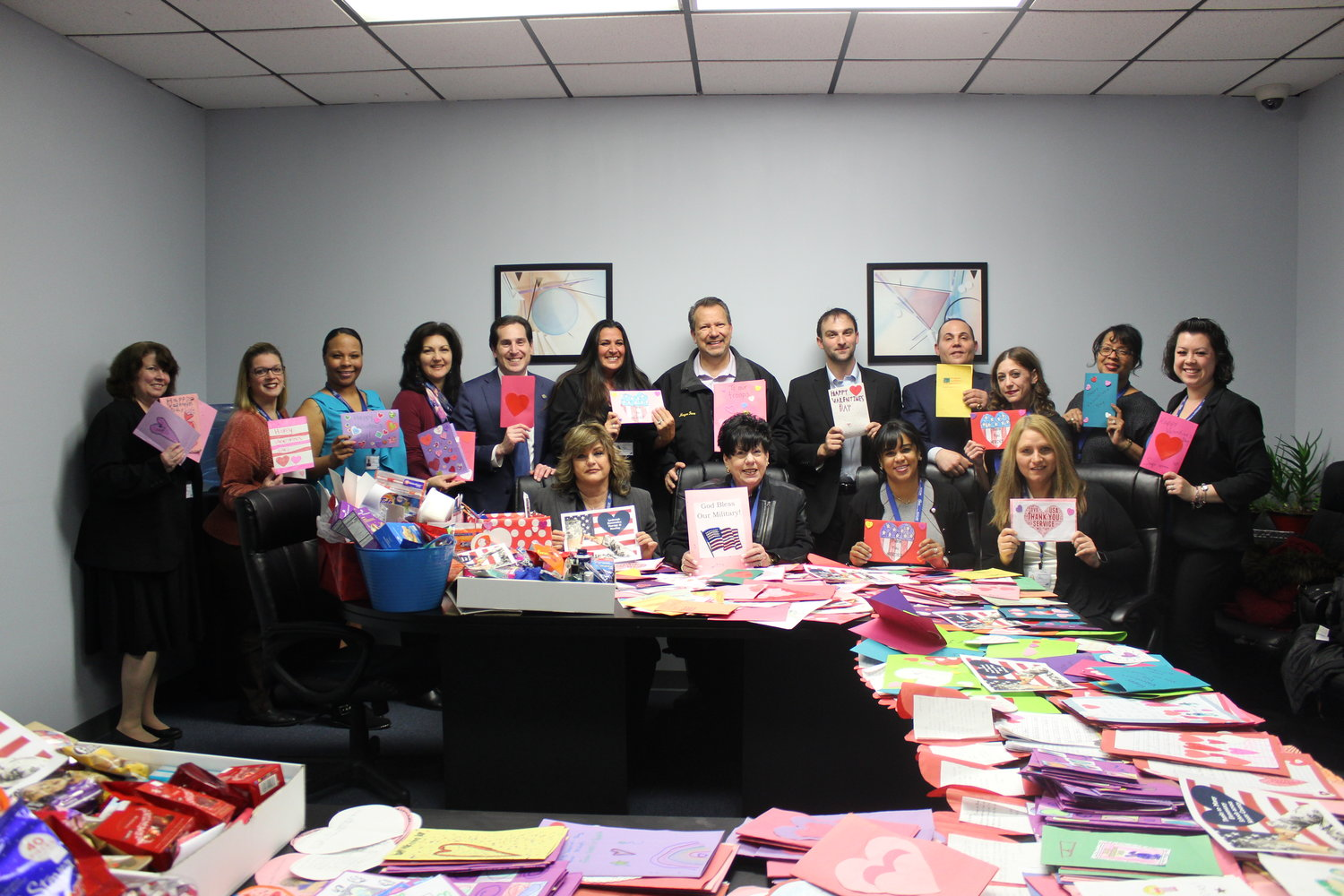 Genine Chiano, sixth from top left, worked with representatives such as SARA Companion HomeCare Services, Lynbrook Restorative Therapy & Nursing, Sen. Todd Kaminsky's office, the Village of Valley Stream and PUDOS to collect and deliver Valentine's Day cards and supplies to an air force troop in Afghanistan.