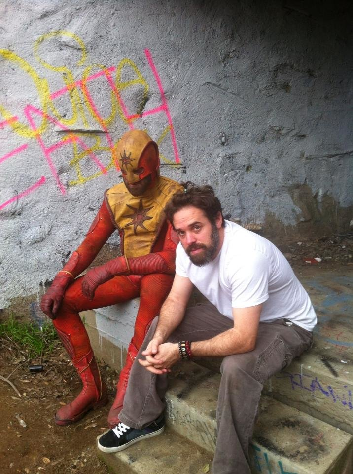 Marcinowski, left, in his costume for the character Solar Flare, and Weil during filming.