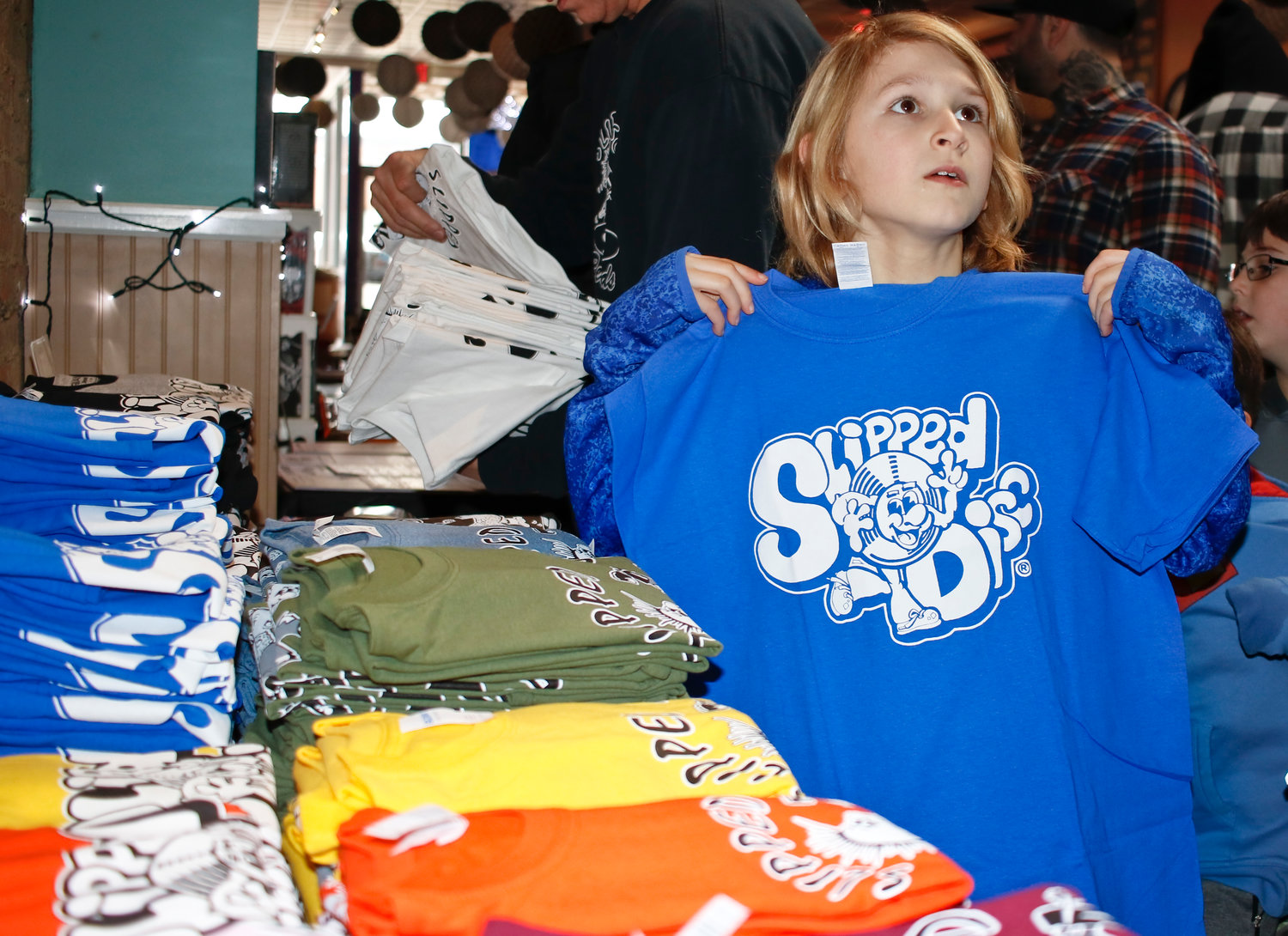 Eight-year-old Luke Healy picked out a retro Slipped Disc T-shirt. The legendary record shop returned to Valley Stream for a day at its former location at Sip This.