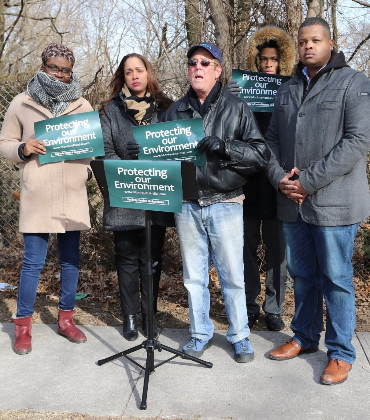 Long-time Elmont resident Andrew Prescia, center, joined community advocates Carl Achilles, right, and Monique Hardial, left, in demanding that Nassau County clean up the storm water basin at Benson and Kiefer avenues.