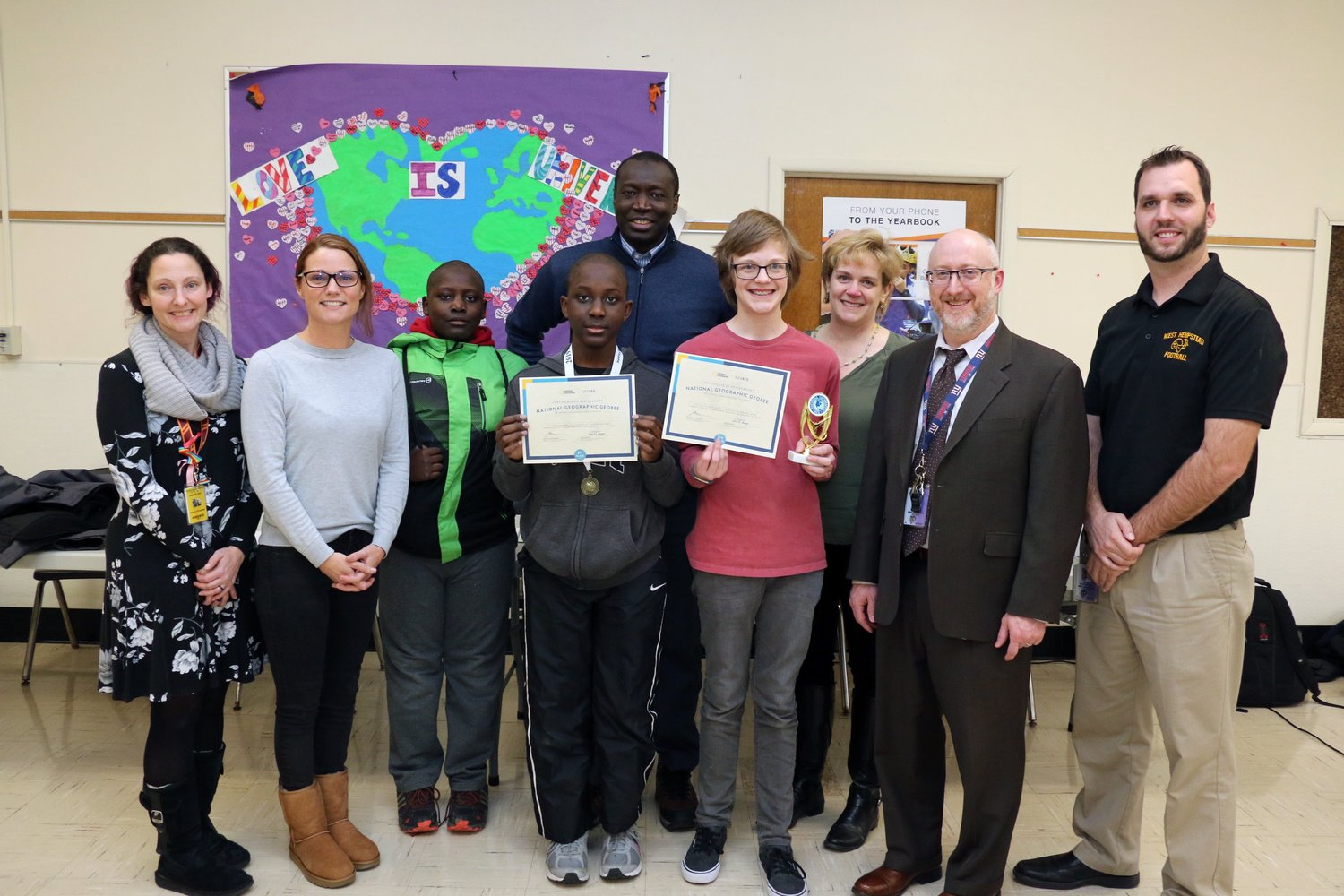 Eighth-grader Mouhammad Seck, fourth from left, above, won the West Hempstead Middle School Geography Bee competition for a third straight year on Jan. 23 while classmate Aiden Sargent was the runner up.