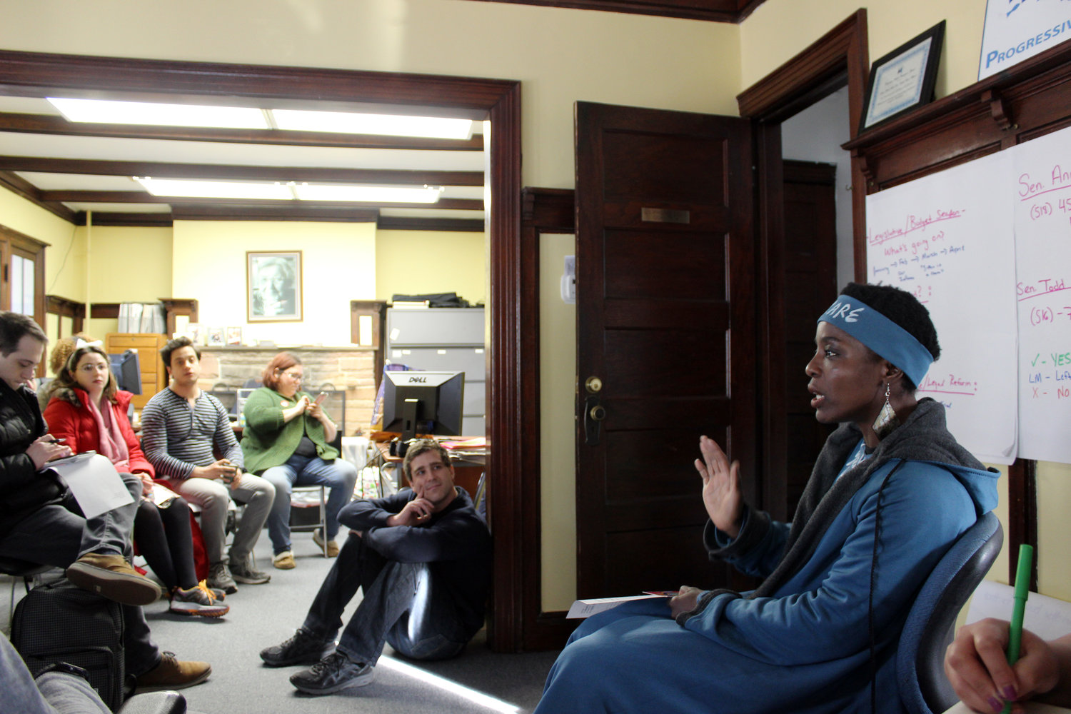 Patricia Okoumou joined with immigration rights activists at the Long Island Progressive Coalition in Massapequa on Feb. 10, where they wrote letters urging Laura Curran to phase out Nassau County's cooperation with the U.S. Immigration and Customs Enforcement agency.