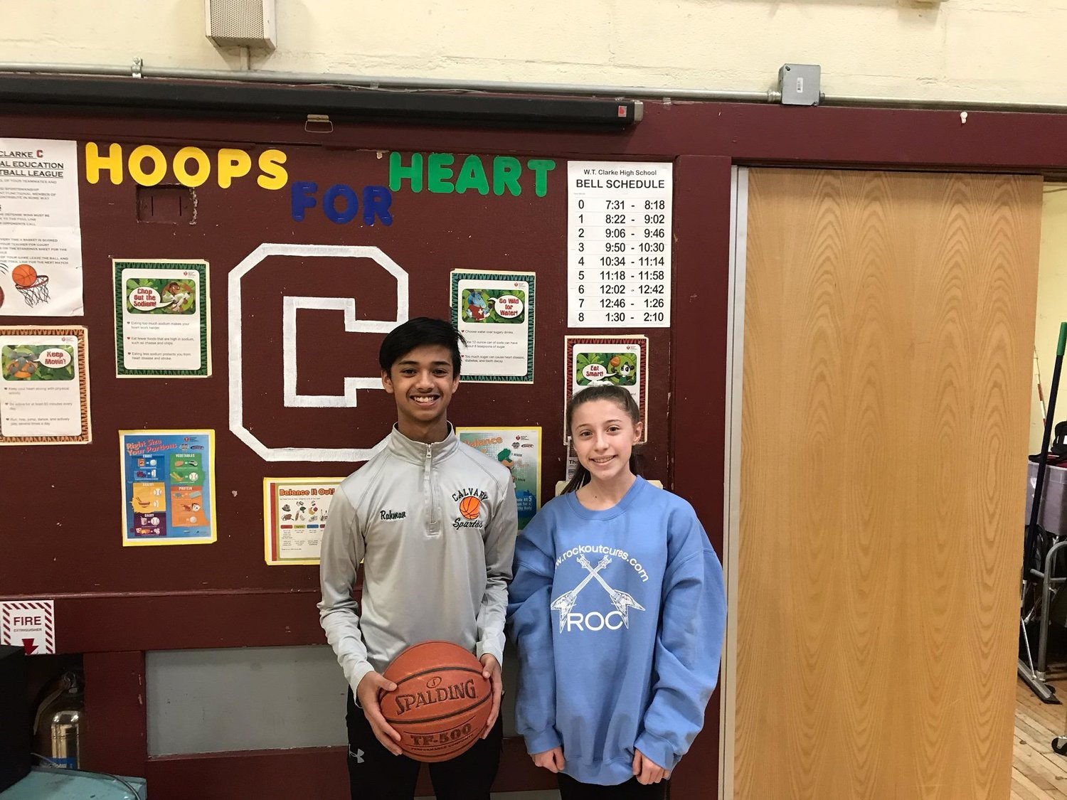 W.T. Clarke Middle School eighth-grade students Tyseer Rahman, left, and Sophia Aprea, right, were among the class winners of a game of knock out during the school's Hoops for Heart tournament from Jan. 23 to Jan. 25.