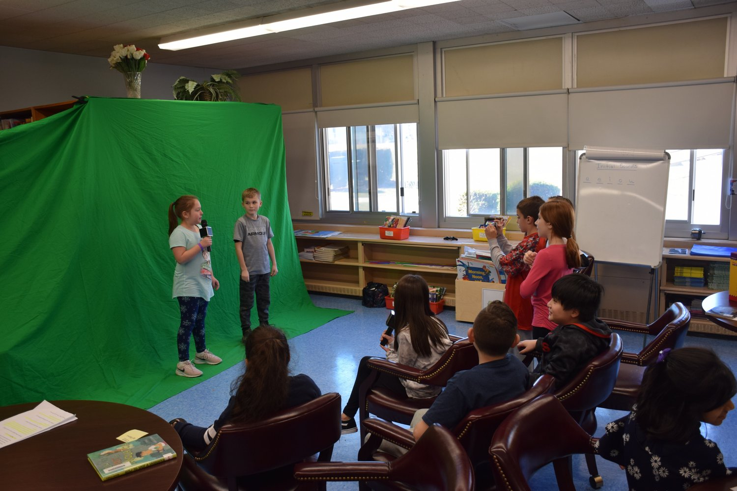 By using a green screen, an iPhone and microphones, fourth-grade students at Parkway Elementary School recorded a news broadcast as part of lesson on natural disasters on Feb. 4.