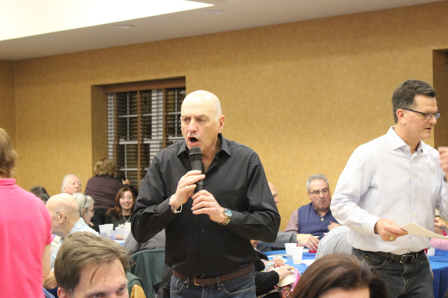 "Alan Hodish led the ""Name that Tune"" game and was one of the organizers of the event, along with Harry Demiris."