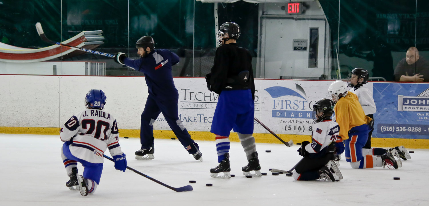 One of the oldest hockey organizations on Long Island, the Arrows league helps children develop their skills. During the developmental portion of practice, Coach Eric Zwerling showed players how to shoot.