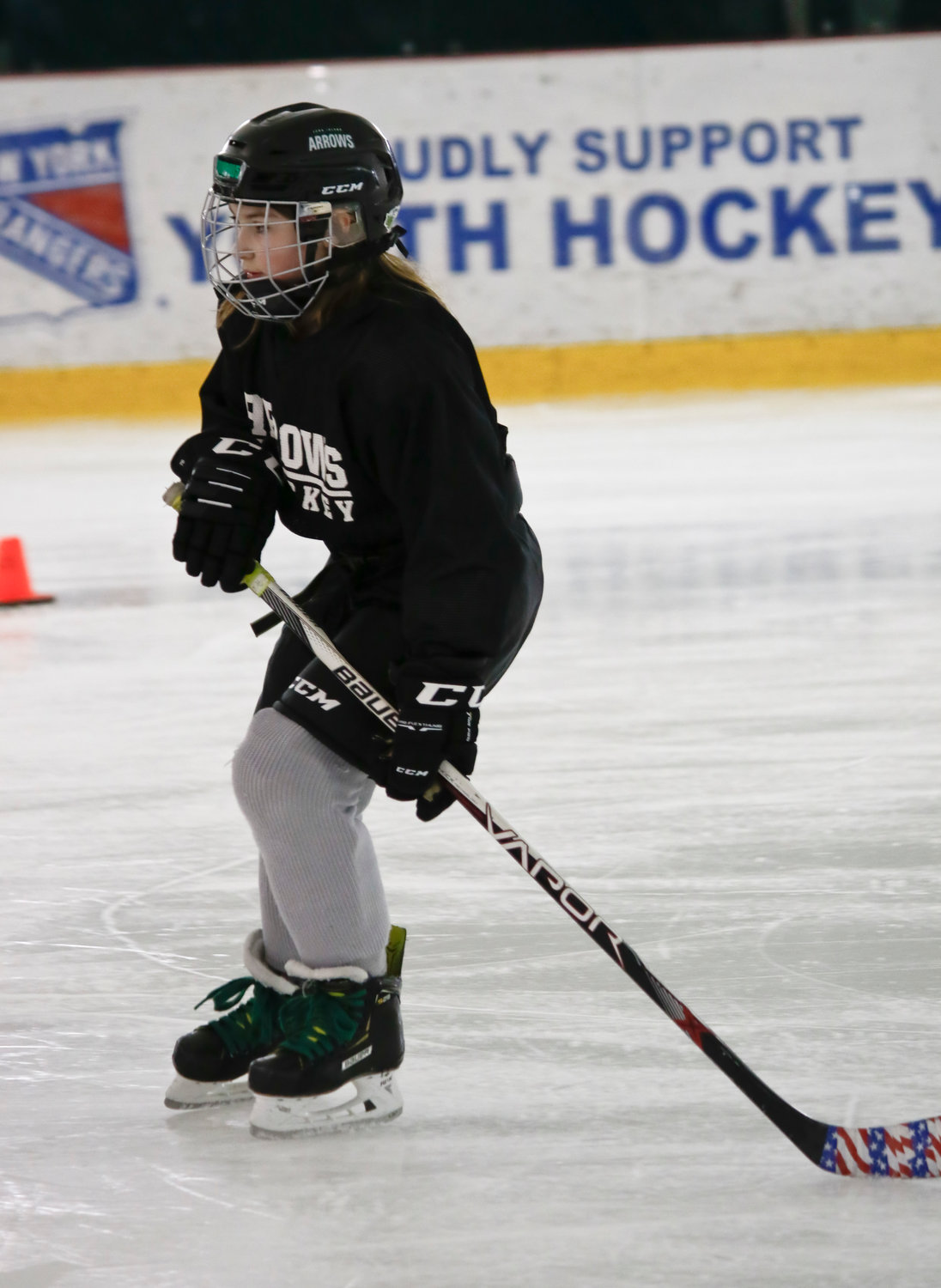 The only female player on the 8U Green team, Emily Stein, did drills during a practice session. The coaches use the American Development Model and cross-ice training to help players reach their full potential.