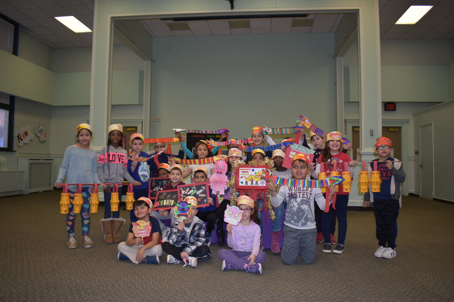 After marching around the building, Barbra Green's second grade class showed off their traditional Chinese masks and decorations.
