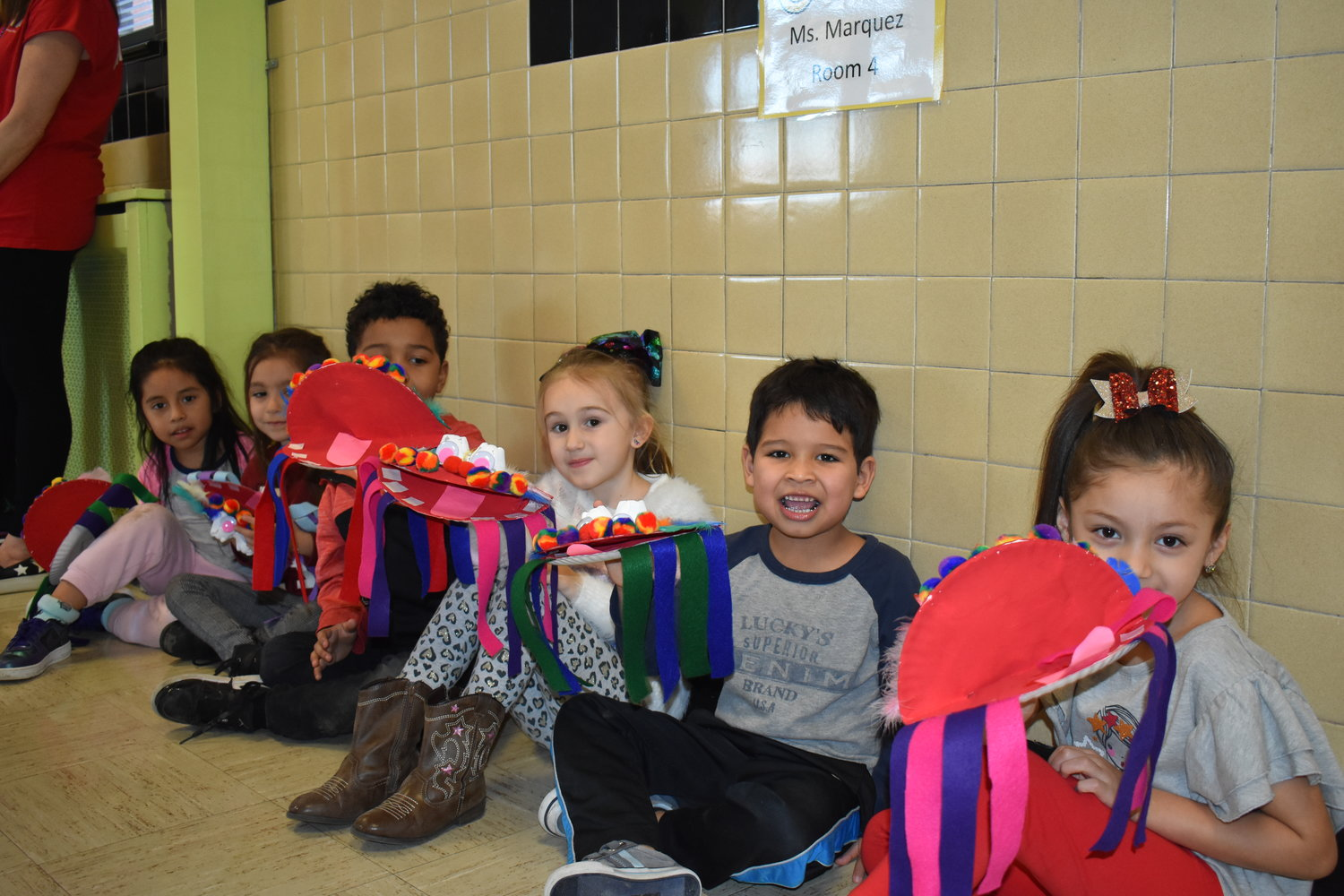 Shari Franklin's kindergartners show off the dragonheads they made out of paper plates during the Chinese New Year parade.