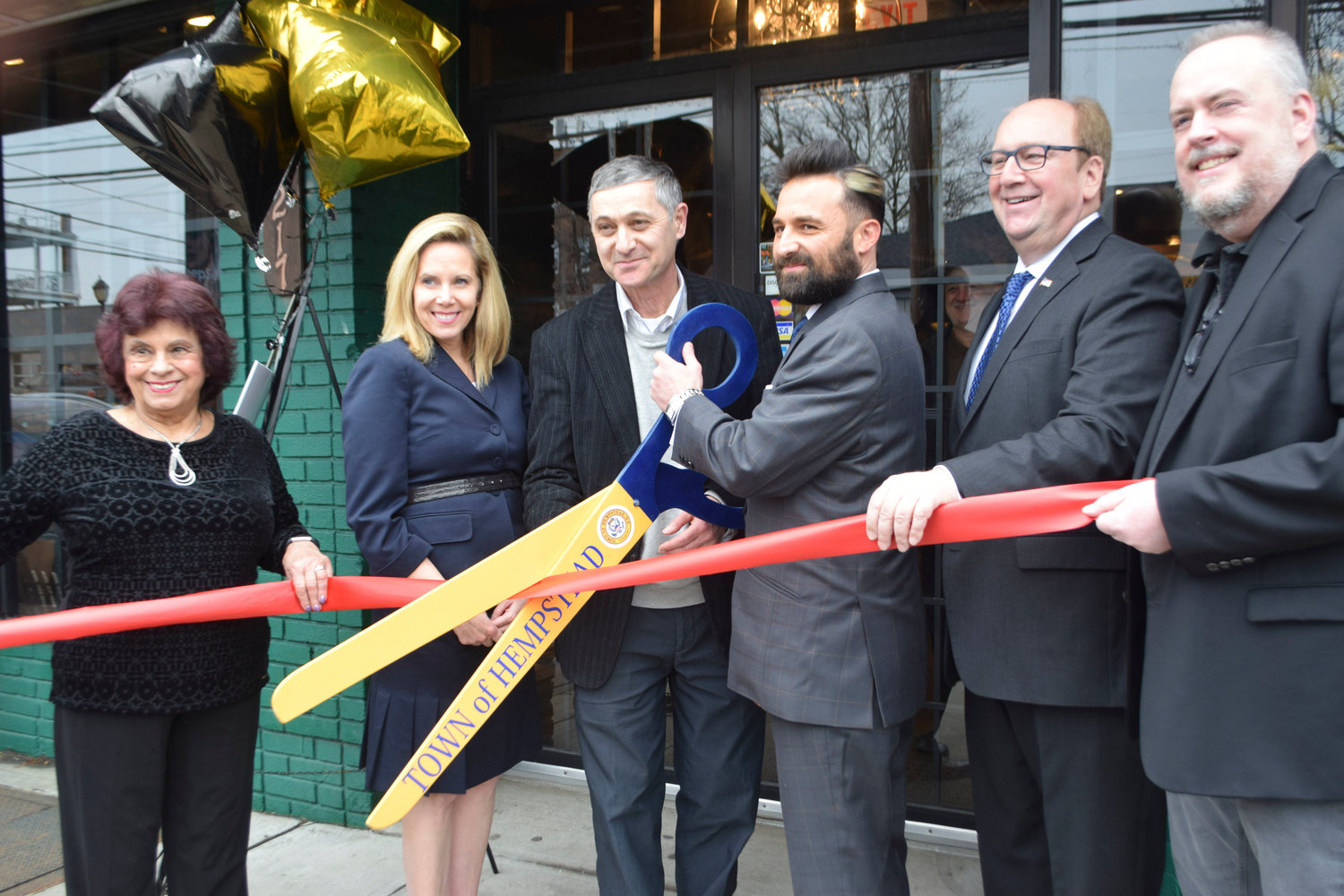 On Broadway in Hewlett, Artistic Men's Grooming has opened. From left active Woodmere resident Ann DeMichael, Hempstead Town Supervisor Laura Gillen, Alex Yakubov, owner Leon Yakubov, Hewlett-Woodmere Business Association President David Friedman and HWBA First VP John Roblin.