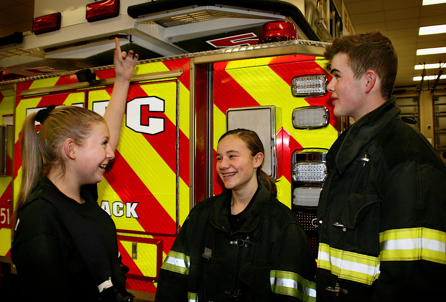 East Norwich Fire Dept. Juniors Kayla Cronin, far left, and Adrianna Wulffen took a break from the training  with Finn Klapproth, a junior visiting from Germany.