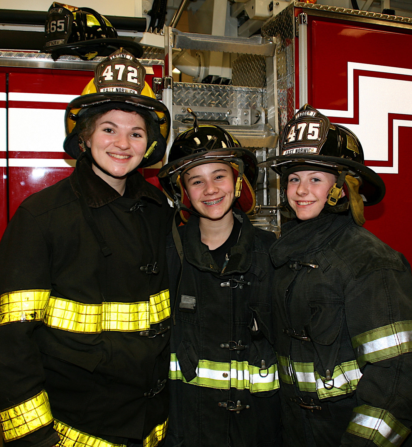 East Norwich Fire Department Juniors Mary Grace Syrett, far left, Arianna Wulffen and Kayla Cronin at the training.