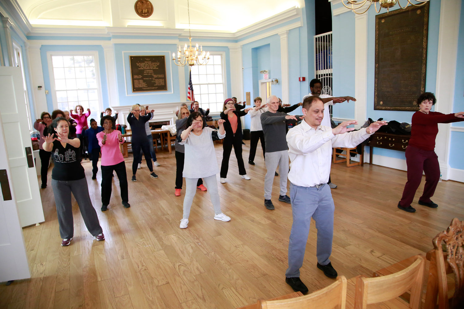 "The library's Tai chi class was full and held in the ""original reading room."""