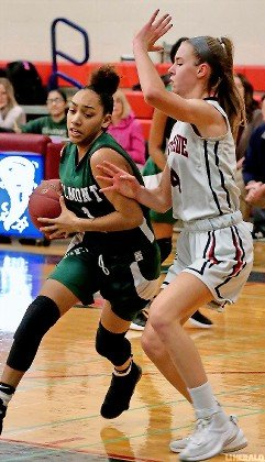 Elmont's Chynna Perez, left, drove against South Side's Sydney Rathjen during last Friday's Class A playoff game won by the Lady Cyclones, 48-39.