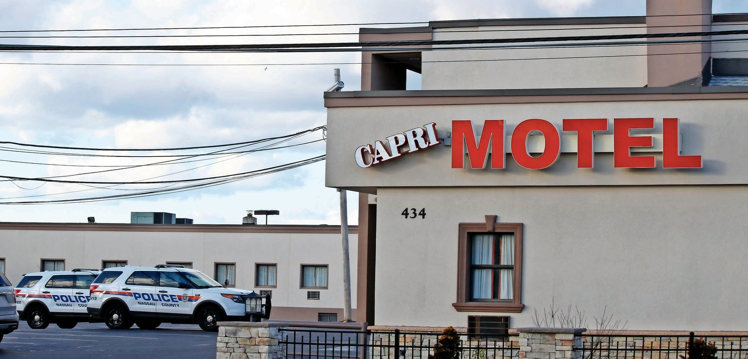 Nassau County police conducted a search for a possible gunman at the Capri Motor Inn in West Hempstead on Monday.