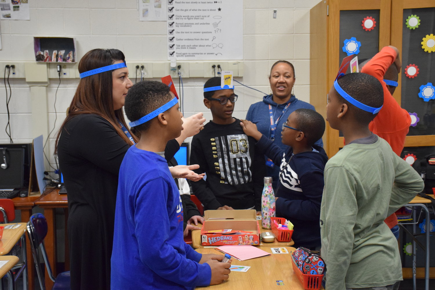"Students played the family-friendly guessing game, ""Hedbanz."""