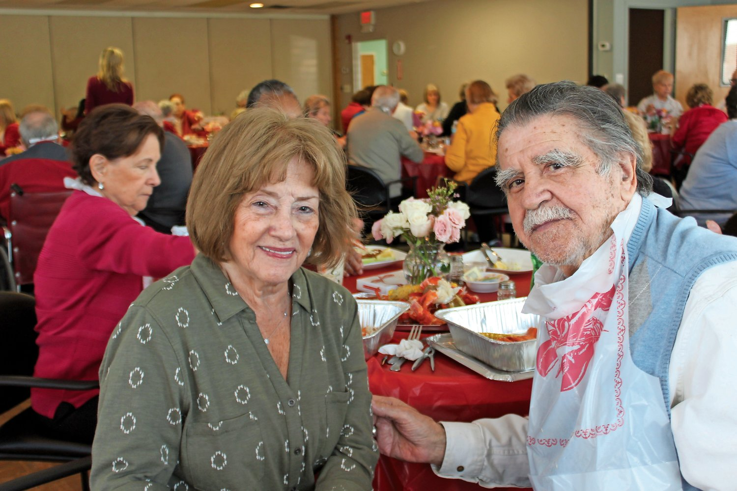 Lilly Carroll and Cass Pena, who have been dating for seven years after meeting at the Sandel Center, enjoyed the Valentine's Day lobster lunch.