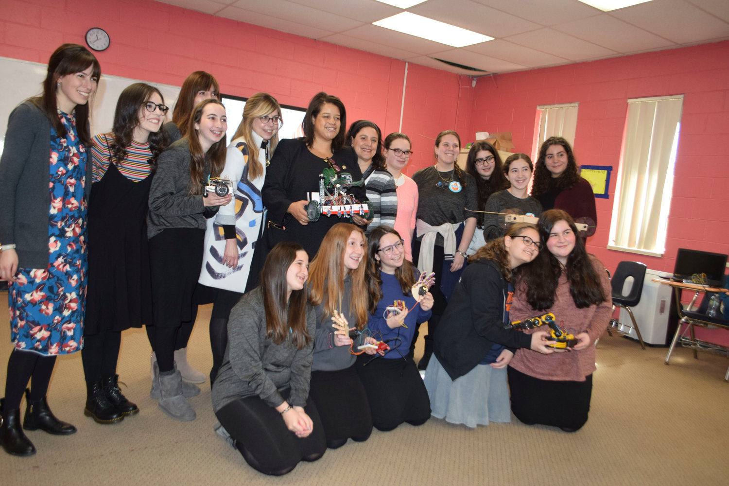 Midreshevet Shalhevet High School students with some of their STEM projects. At far left is science teacher Aliza Feder. Principal Esther Eisenman is fifth from left, and State Assemblywoman Michaelle Solages is to her left.