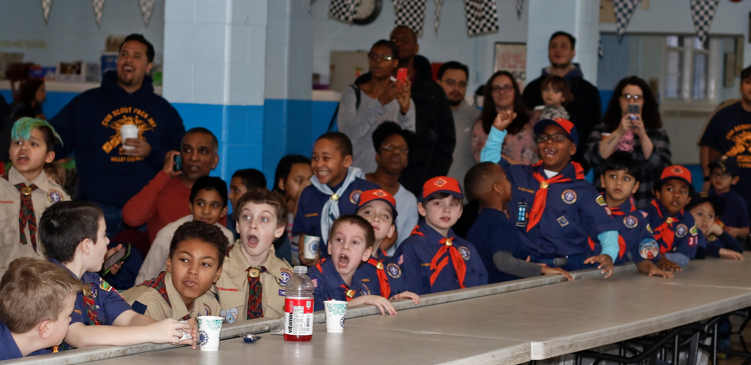 The scouts of Pack 367 watched as Pinewood Derby cars reached close to 195mph.