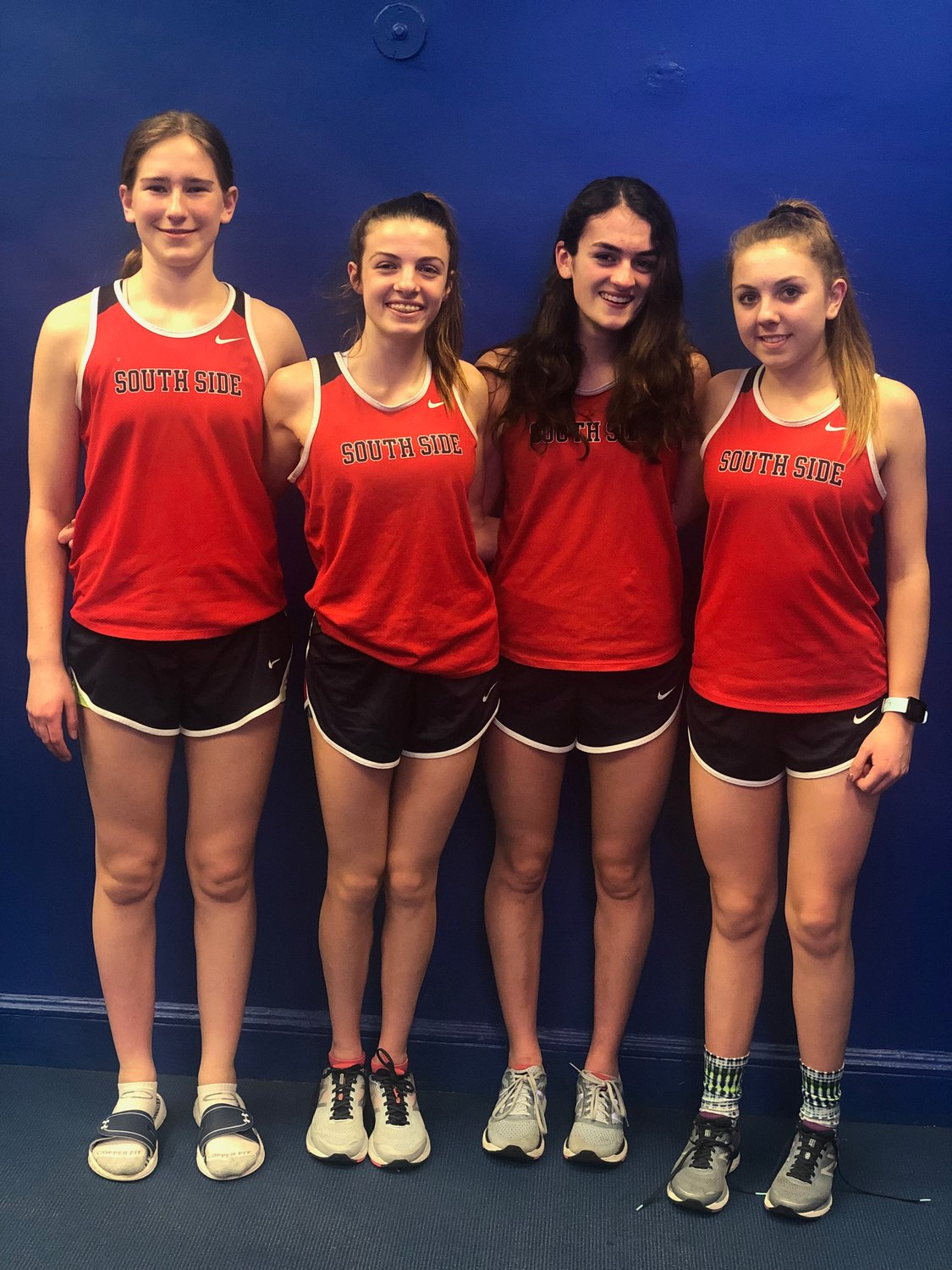Carly Woelfel, left, Olivia Duca, Avery Brull and Kaitlyn Mohr, were county champions in the 4x800-meter relay on Feb. 5.