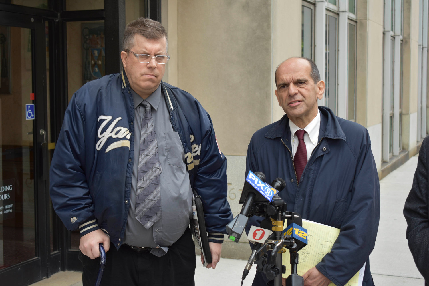 Boston attorney Mitchell Garabedian, right, who has handled hundreds of sexual abuse cases, spoke at a news conference in October 2017. He stood beside sexual abuse survivor Thomas McGarvey.