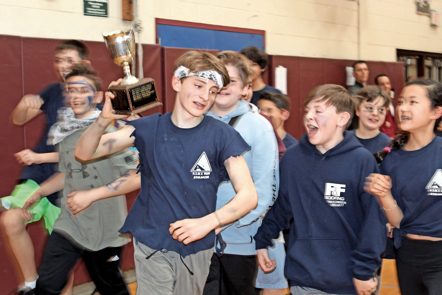 Seventh grader Luke Potapov took a victory lap after Team Avalanche prevailed.
