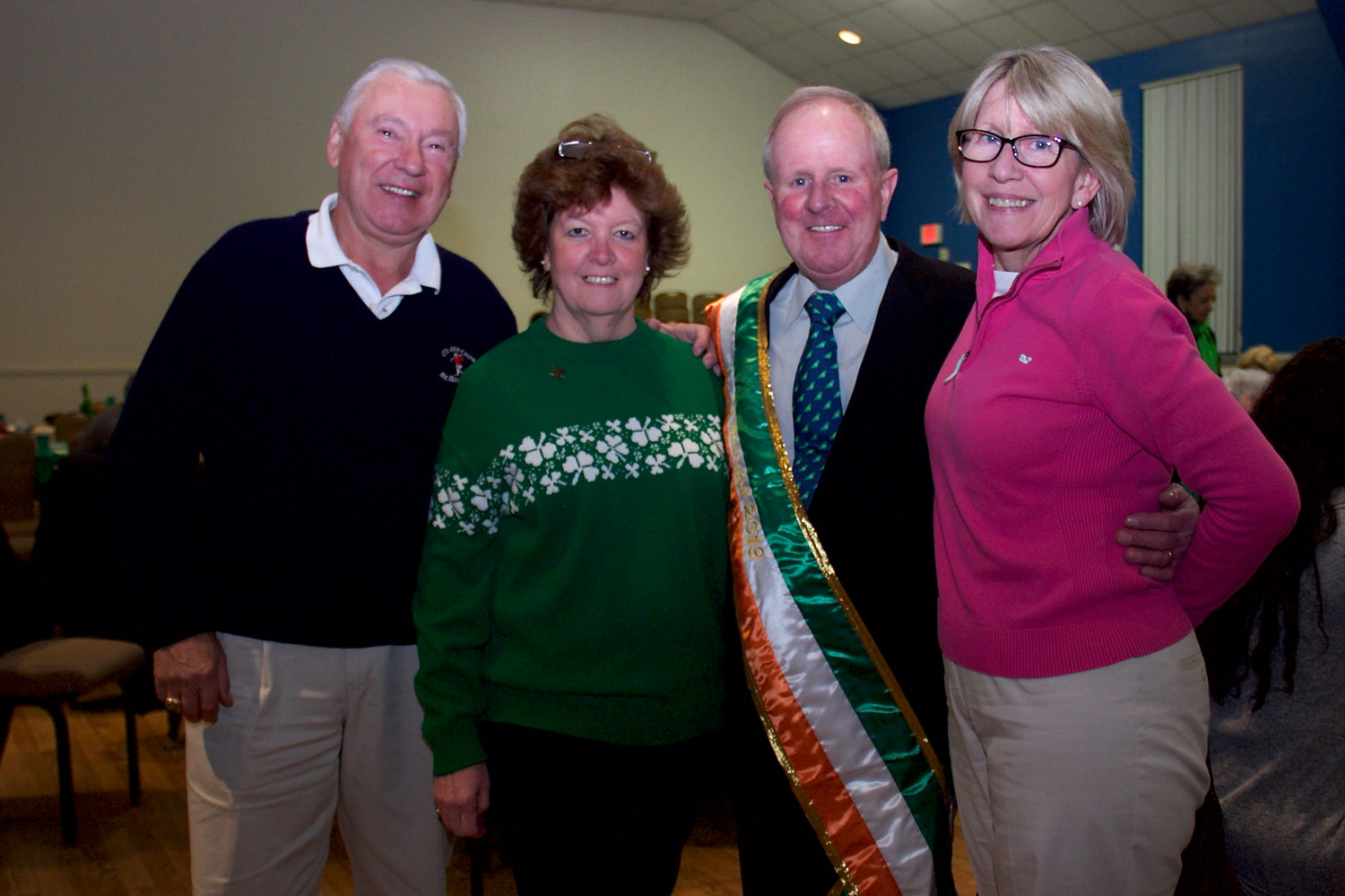 Newly named grand Marshal Patsy Furlong, in sash, celebrated with his wife, Nancy, and their cousins Alex and Brenda Rizea.
