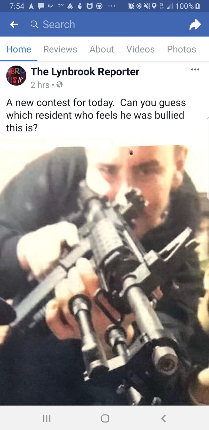 The anonymously run Lynbrook Reporter Facebook page posted this image of a man holding a semi-automatic weapon, which moved Deputy Mayor Hilary Becker to file a police report.
