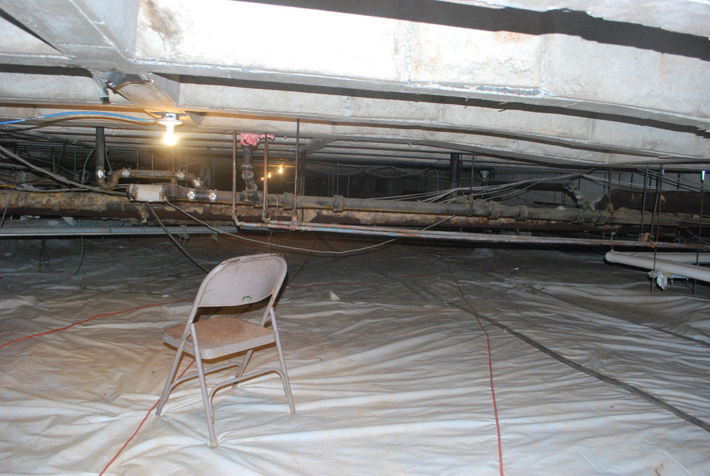 With more than $14 million from FEMA and New York state, Lawrence School District officials look to renovate the high school, which was severely damaged in Hurricane Sandy. Above, the LHS crawl space after clean up.