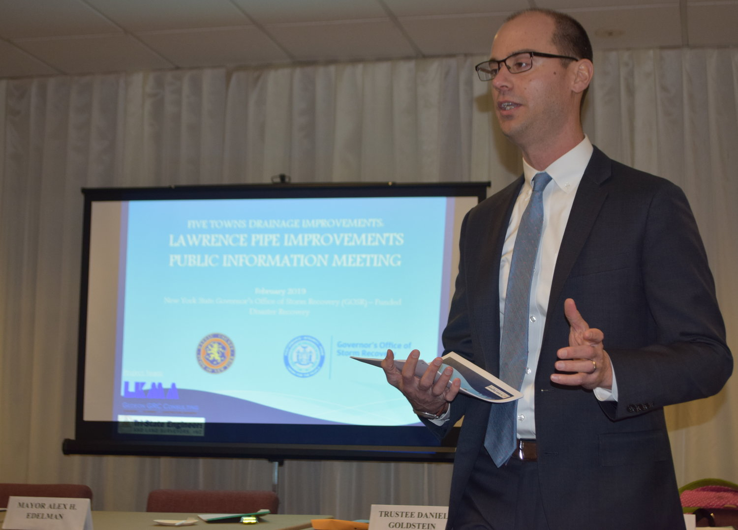 Nassau County Deputy Planning Commissioner Sean Sallie introduced the Lawrence drainage improvement project at the village board meeting on Feb. 14.