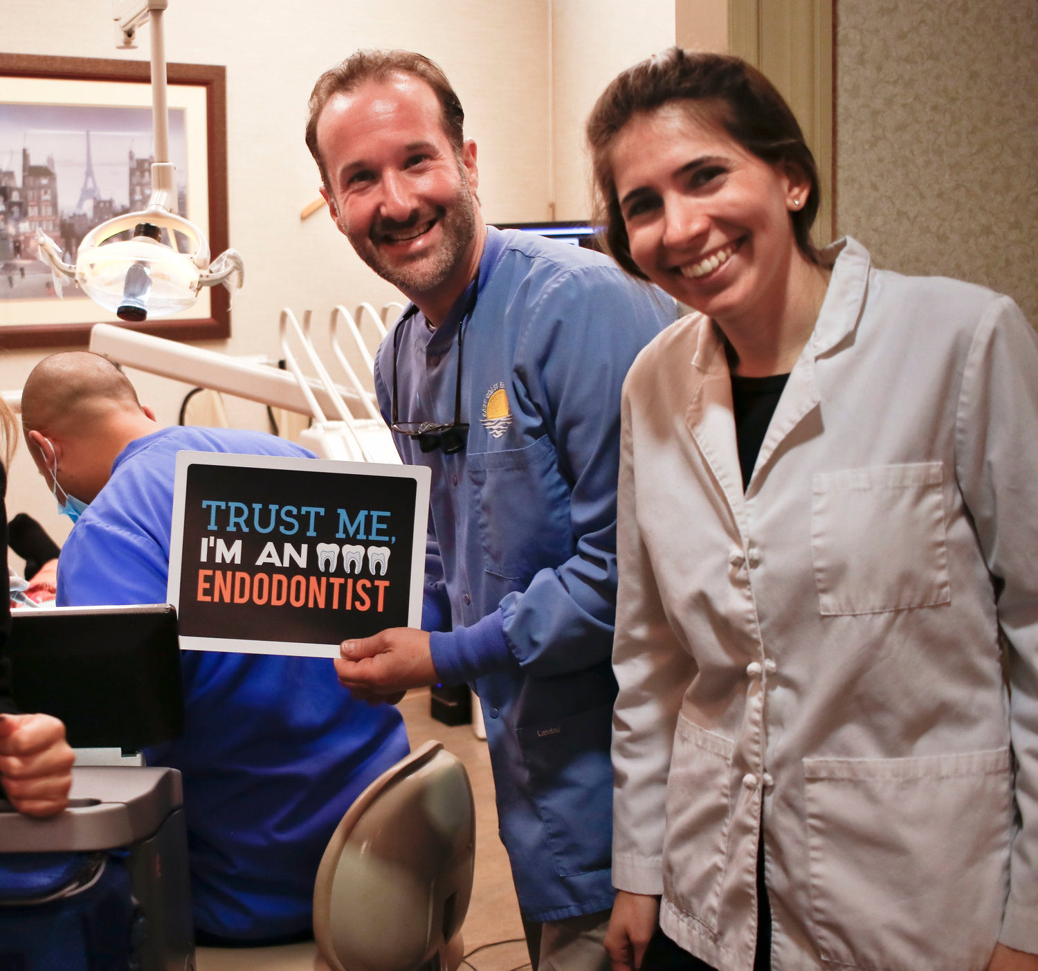 "Drs. Evan Chugerman and Rebecca Gottlieb had fun showing a personalized sign. The other side reads ""My Endodontist knows my roots."""
