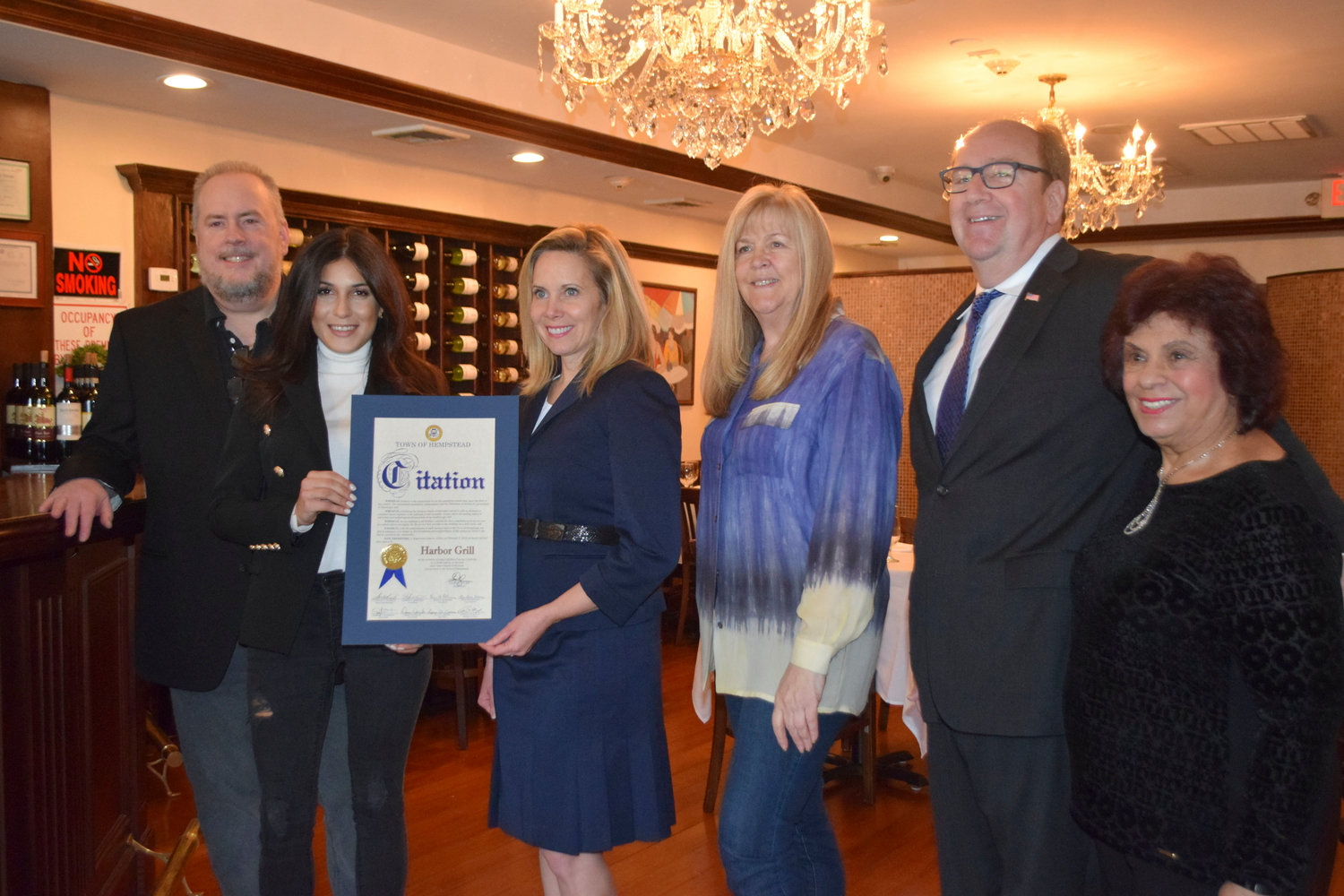 A grand opening ribbon-cutting for Harbor Grill was held on Feb. 7. From left HWBA First Vice President John Roblin, owner Gabriela Rozengauz, Town of Hempstead Supervisor Laura Gillen, HWBA Secretary Loretta Camarda,  HWBA President David Friedman and active Woodmere resident Ann DeMichael.