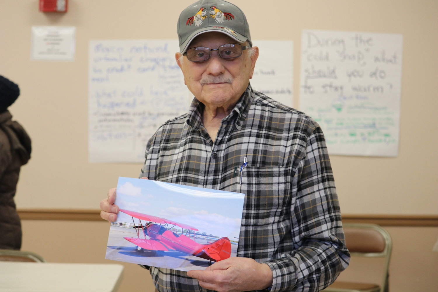 Joseph Cirina, 86, showed a photo of the remanufactured Waco UPF-7 biplane, that he flew in 2018. This airplane was originally manufactured from 1937 to 1942.