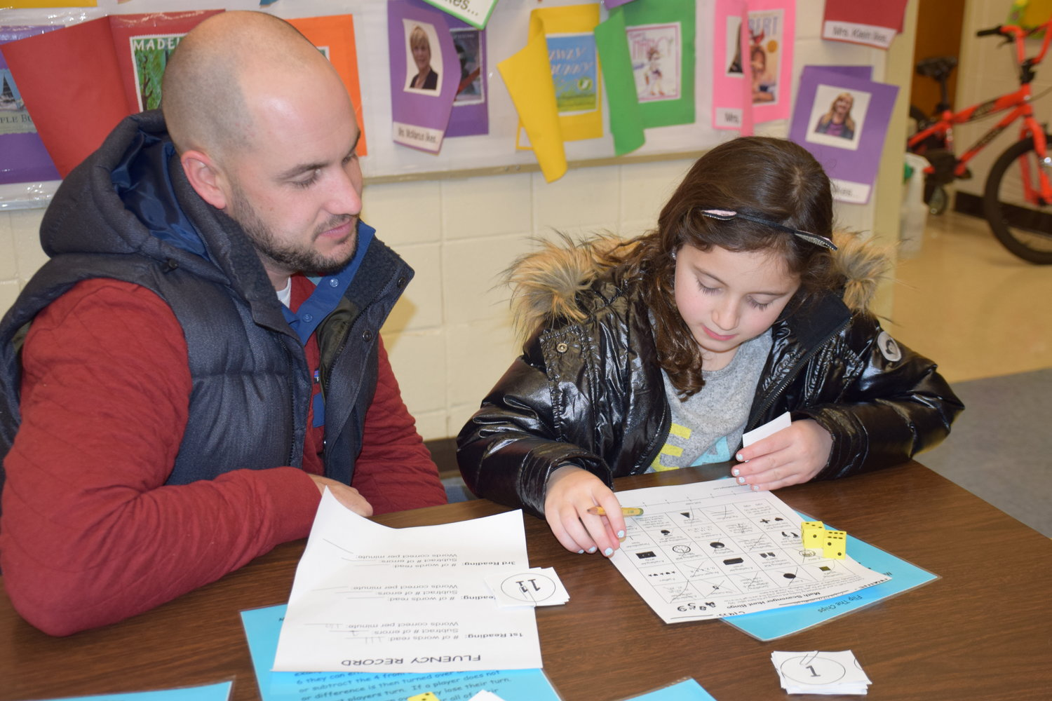 Gianna Calonita came with her father, Richard Calonita, to Bayville Primary's Family Math/ELA Night.