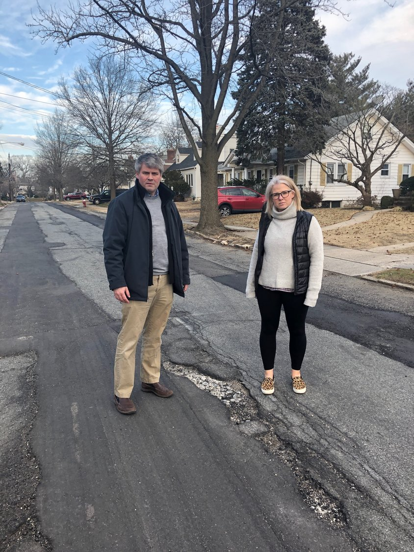 Deputy Mayor Keith Corbett and Trustee Lauren Touchard on Wagg Avenue, one of several streets that must be repaved in the village.