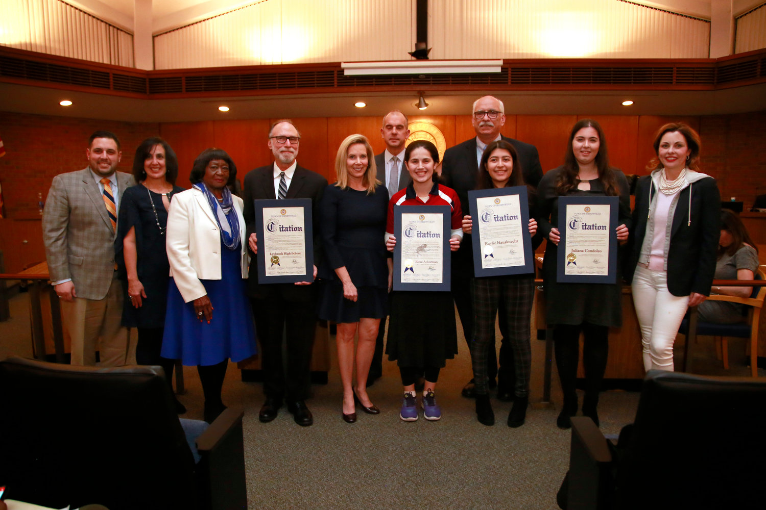 West Hempstead teen Estee Ackerman, center, wearing red, received a citation from the Town of Hempstead on Feb. 5 for winning two gold medals in table tennis.