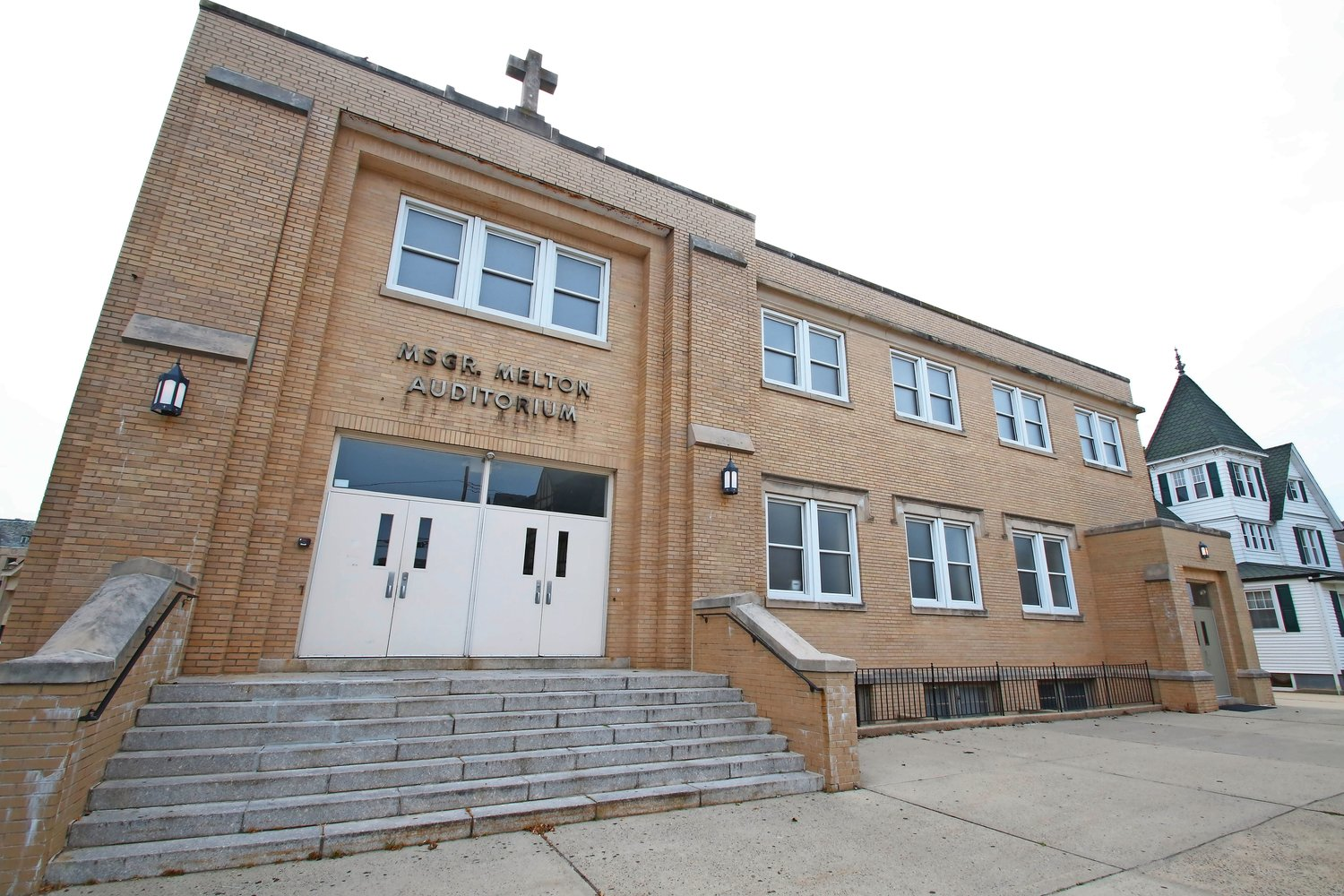 The auditorium at St. Agnes is named after the late Melton, who was one of three clergy accused of sexual abuse last week.
