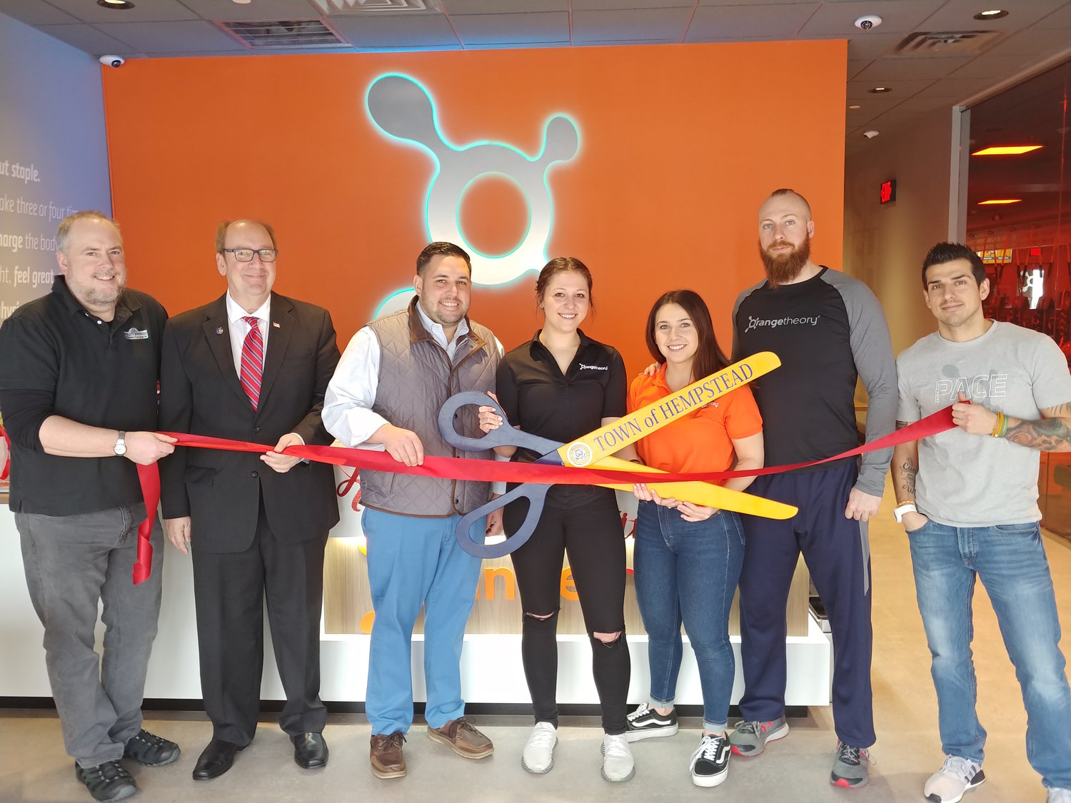 Hewlett welcomed a new business as Orangetheory Fitness opened on Broadway. From left Hewlett-Woodmere Business Association First Vice President John Roblin, HWBA President David Friedman, Councilman Anthony D'Esposito, and center employees Molly Bastow, Rianna Valinoti, RJ Cincotta and Nick Locicero.