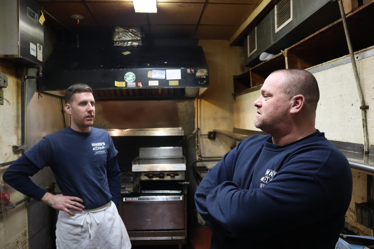 "David Brown and Craig Jeffrey shared memories in Ward's kitchen. Brown compared the closing day on Feb. 23 to a ""funeral"" for the deli, which had been operating in Merrick for at least 30 years."