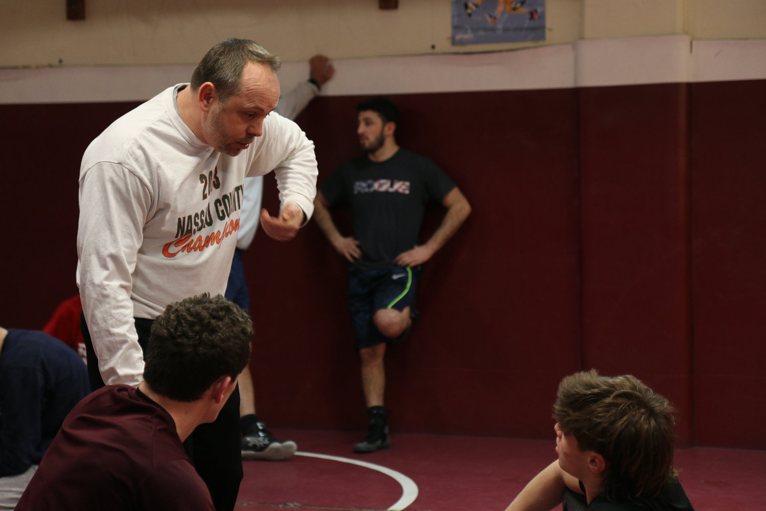 North Shore High School wrestling coach Michael Emmert offered some skillful advice to his athletes.
