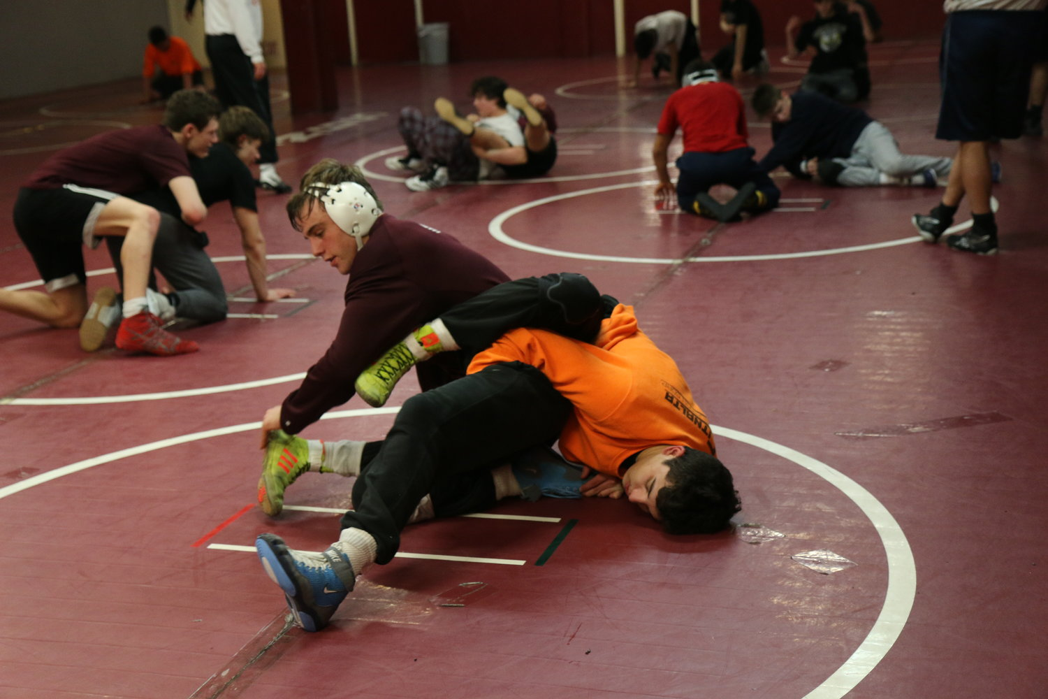 Steven Grabher wrestles with his teammate, Chris Milo.