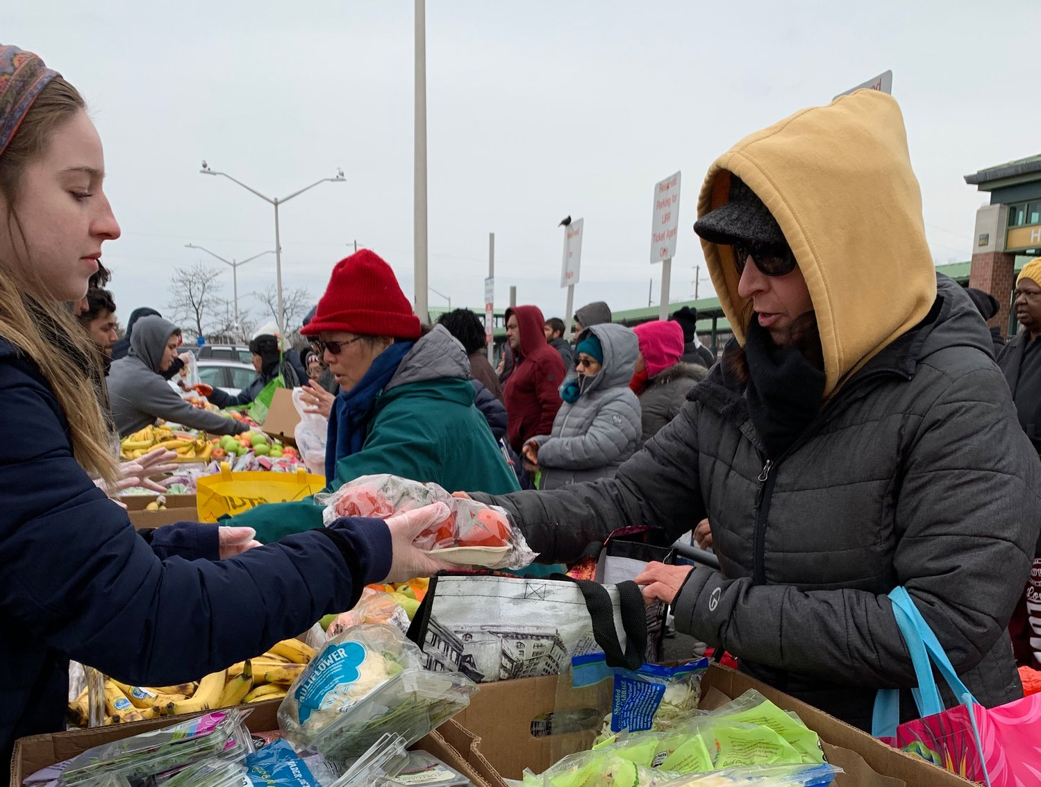 A volunteer makes sure to give people the vegetables they prefer.