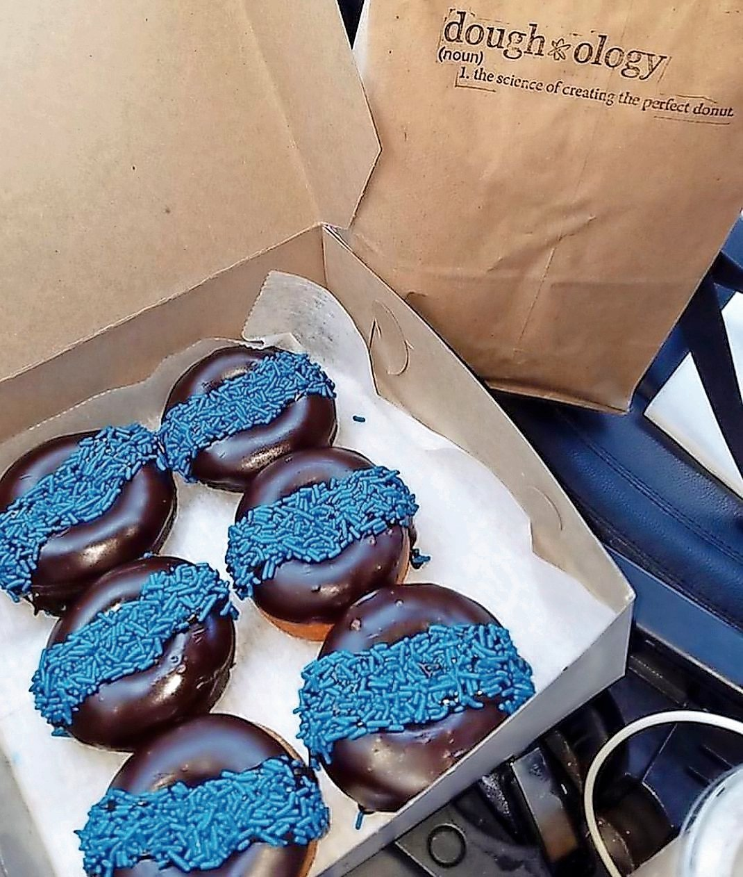Whenever Chris Stiasen, the owner of Doughology in Lynbrook, learns about a police officer's death, he sells doughnuts with a blue stripe to collect funds for the victim's family.