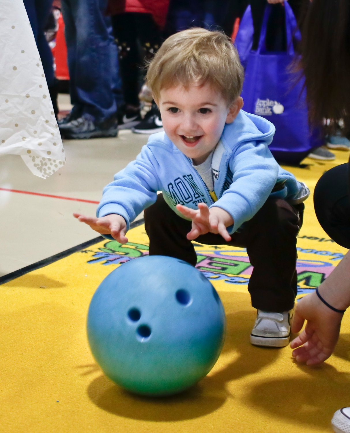 The Maple Family Centers set up a bowling lane for children, and Zachary Wiener, 2, of Oceanside, had fun trying for a strike.