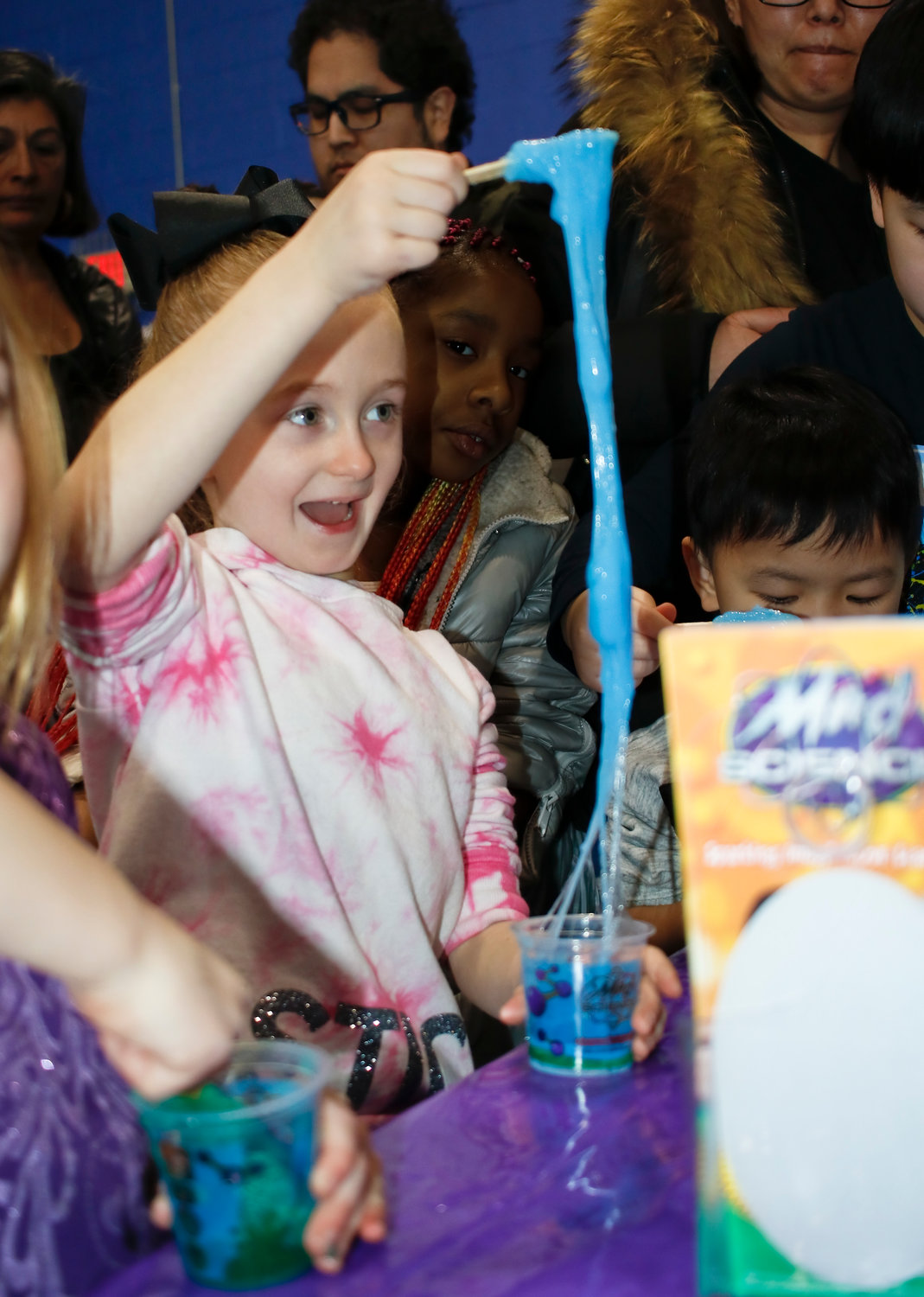 One of the most popular booths at the event was the Mad Science slime-making bar. Ava Pagnotta, 6, of Oceanside, tested how far she could stretch her slime.