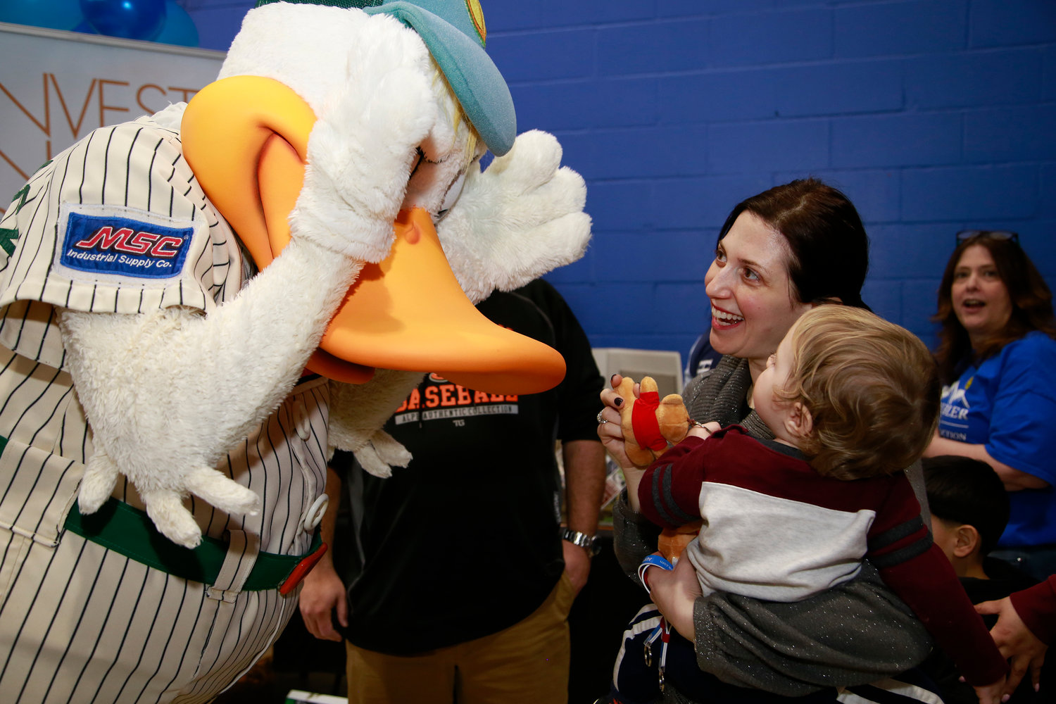 Long Island Ducks mascot Quacker Jack played peek-a-boo with 10-month-old Benjamin Tarasuk and his mom, Debbie.