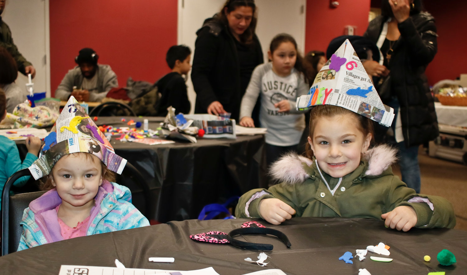 Leah and Zoey Macchia, of Wantagh, donned their decorated newspaper hats.