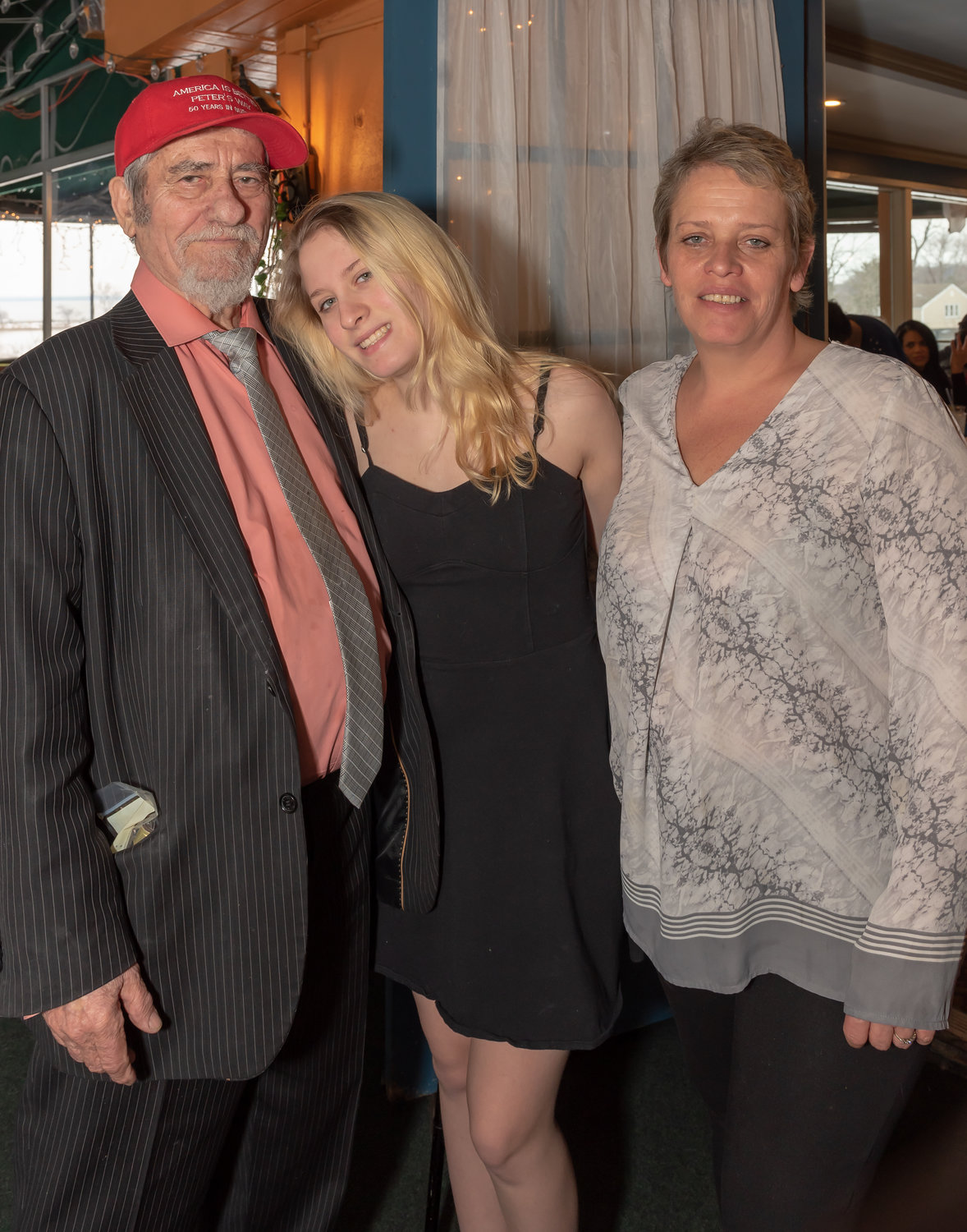 Peter Antonopoulos, co-owner of the View Grill, celebrated 50 years in business in Glen Cove with, among others, his granddaughter Taylor Riley and his daughter, Carol.