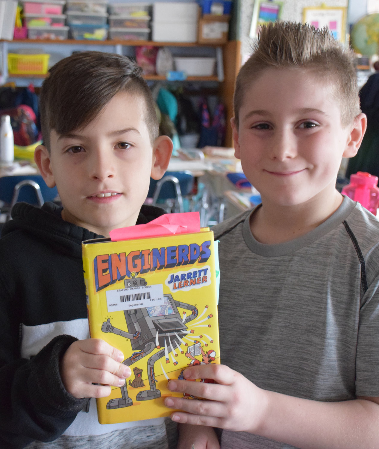 "Seaford third-graders Anthony Kuffo, left, and Brock Conway said they enjoyed Lerner's book ""Enginerds."""
